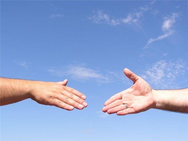 Мусафаха (приветствие) двумя руками