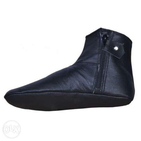 Если кожаные носки (хуффы) спадут ниже щиколотки, нарушается ли омовение?